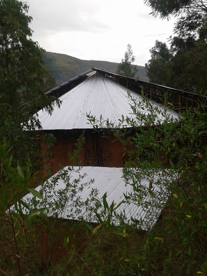 Side right view of the orutindo hut after new roof.